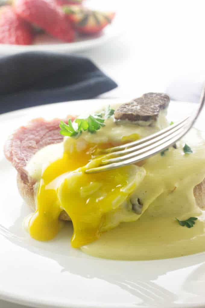 Slicing into the yolk of an egg with Truffled Hollandaise Sauce.