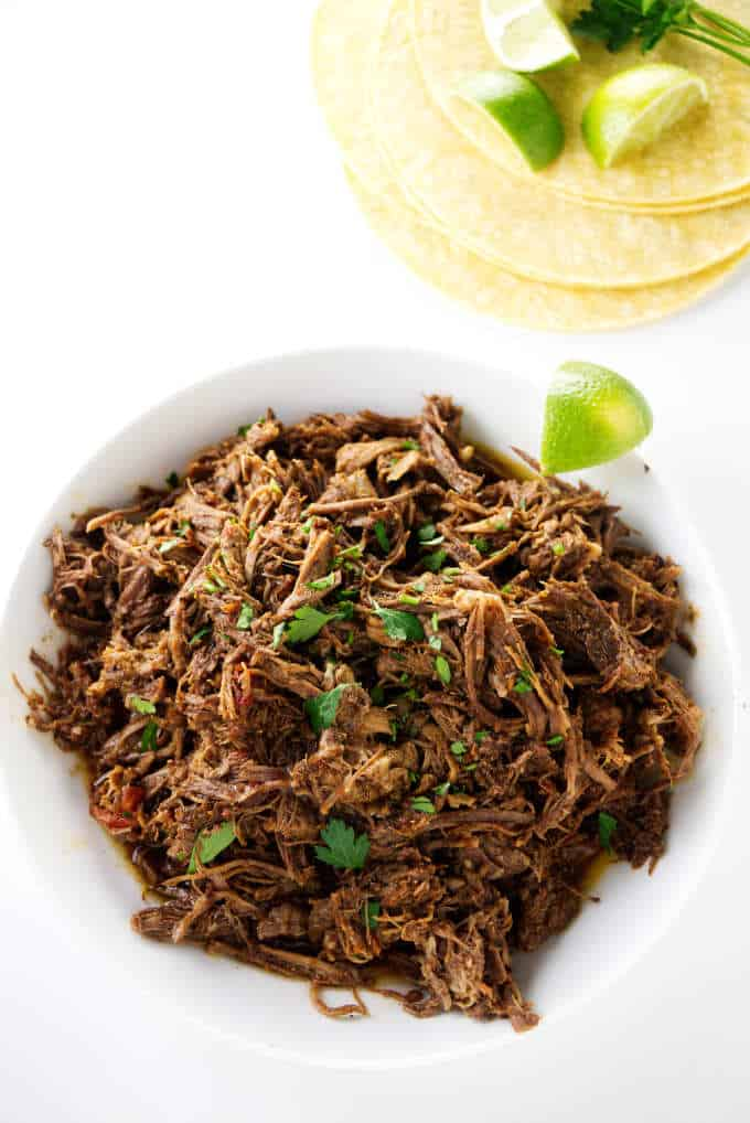 Shredded beef and some corn tortillas.