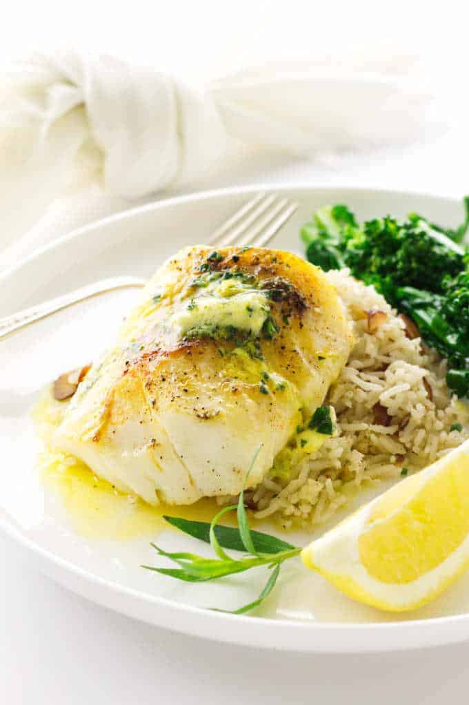 Pacific Cod with Lemon Tarragon butter melting on Basmati Rice Pilaf