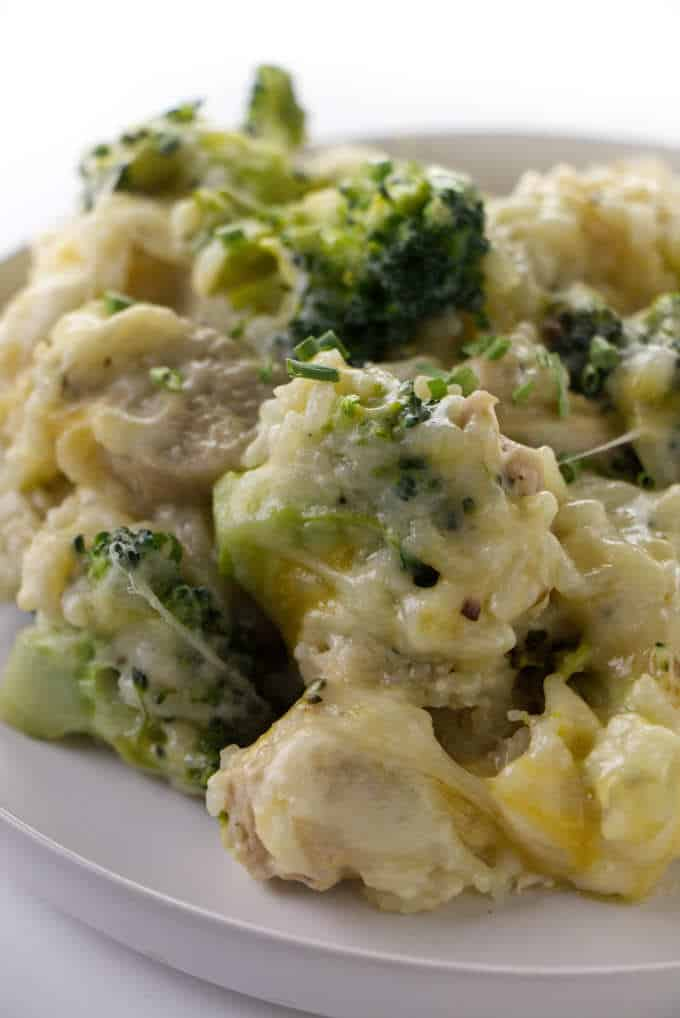 Chicken broccoli and rice casserole on a serving plate.