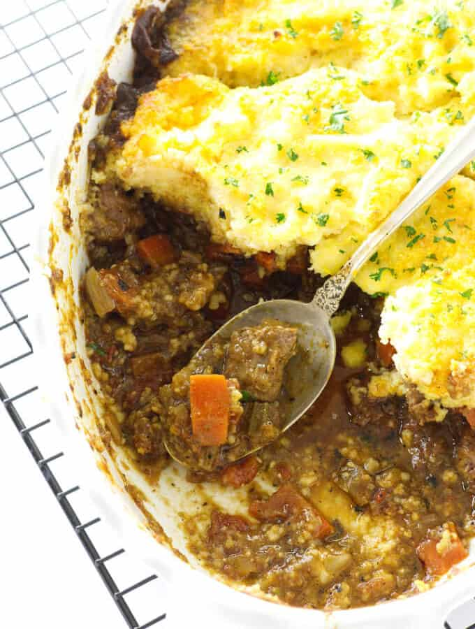 Overhead view of ossobuco casserole and serving spoon