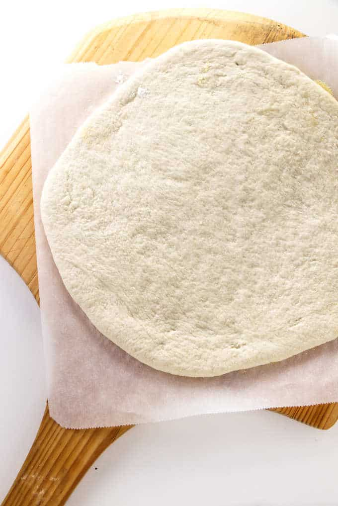 Sourdough pizza crust rolled into a 12 inch round.