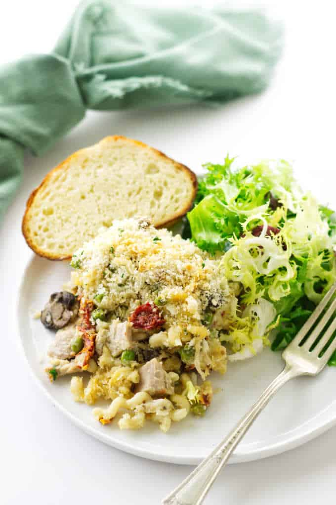 Serving of turkey Tetrazzini with salad and bread.