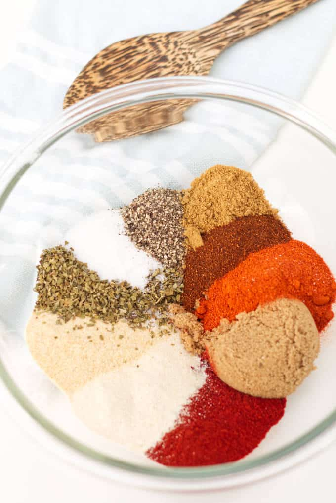 Several spices in a bowl ready to be mixed for a barbeque seasoning.