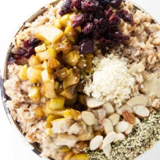 An overhead photo of hot rolled spelt cereal with toppings.