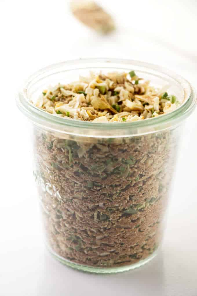 A jar filled with onion soup mix.