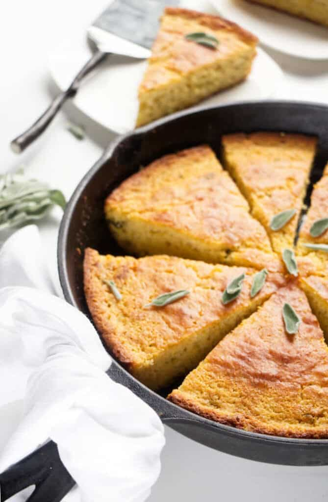 Sage brown butter skillet cornbread in a cast iron skillet.