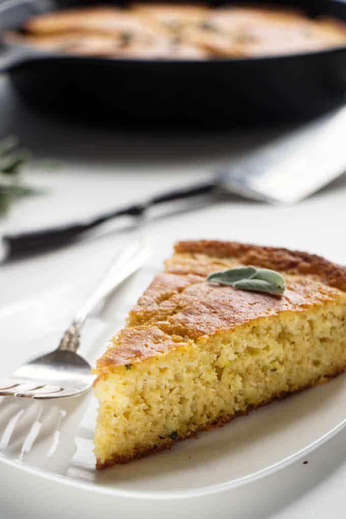 A single slice of cornbread on a plate.