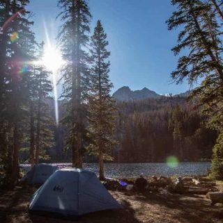 photo of tents near water