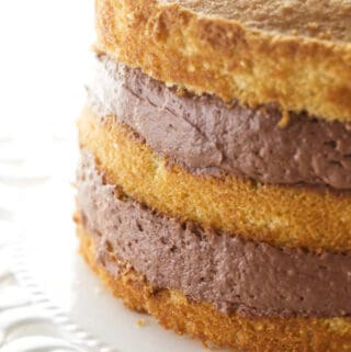 chocolate cake filling between three layers of cake.