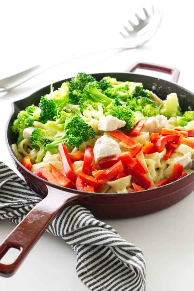 Skillet with pasta, chicken, broccoli and bell pepper in creamy sauce