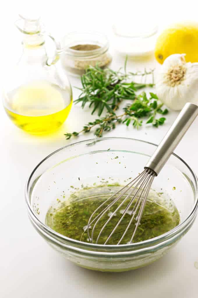 Ingredients and dish of marinade, whisk in dish