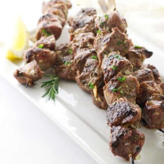 overhead view plate of lamb kabobs