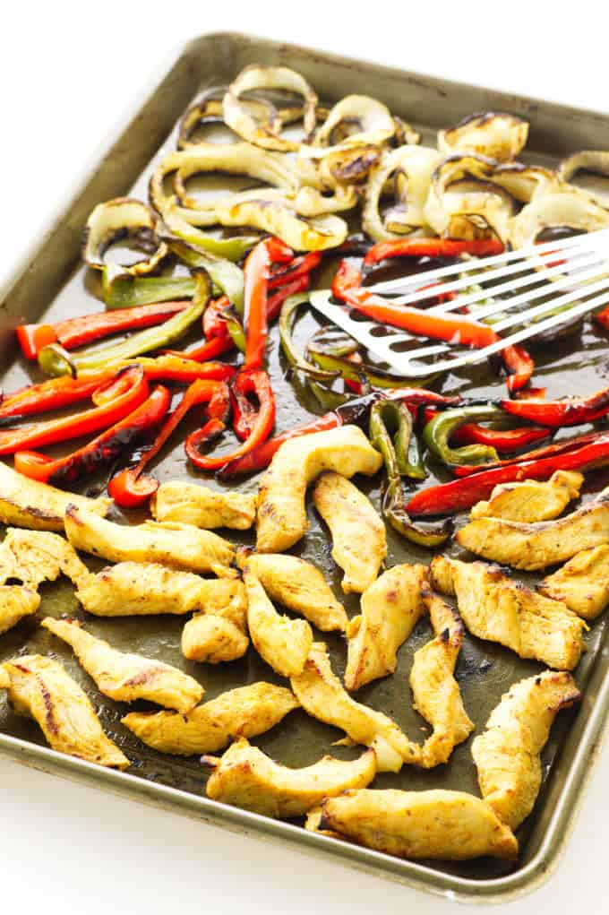Sheet pan with grilled chicken, red/green peppers and onion rings