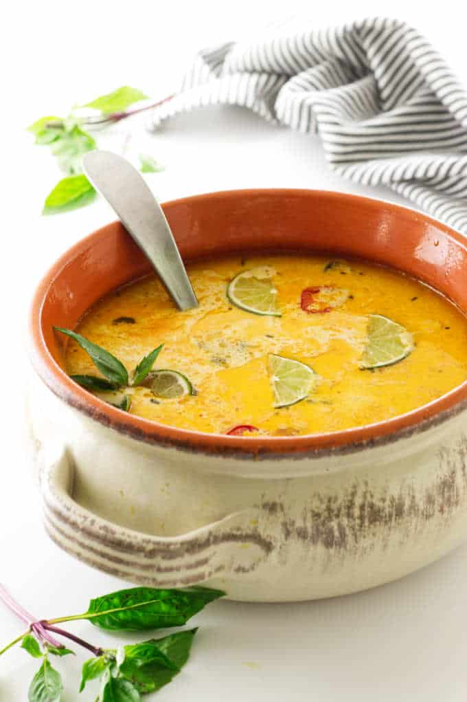 Soup pot filled with coconut chicken soup,