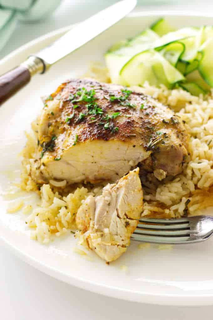 Close up view of chicken with a bite on a fork