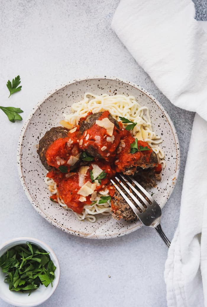 keto Italian meatballs on a plate with parsley on the side