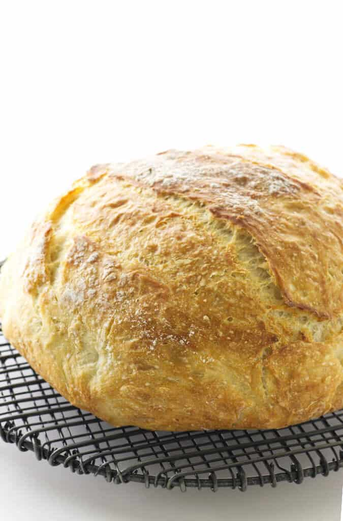 Baked Dutch oven bread on cooling rack