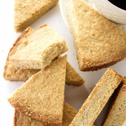 Slices of oatmeal shortbread and a cup of coffee.