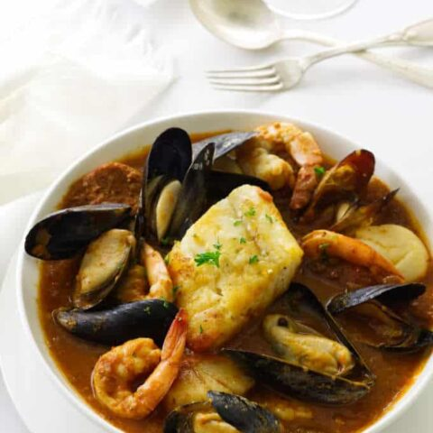 Seafood stew of mussels, scallops, shrimp, chorizo sausage and Pacific cod in a spicy sauce