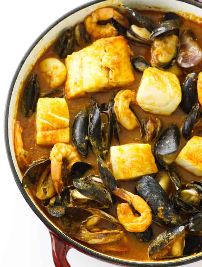 Large pot of seafood in a spicy sauce