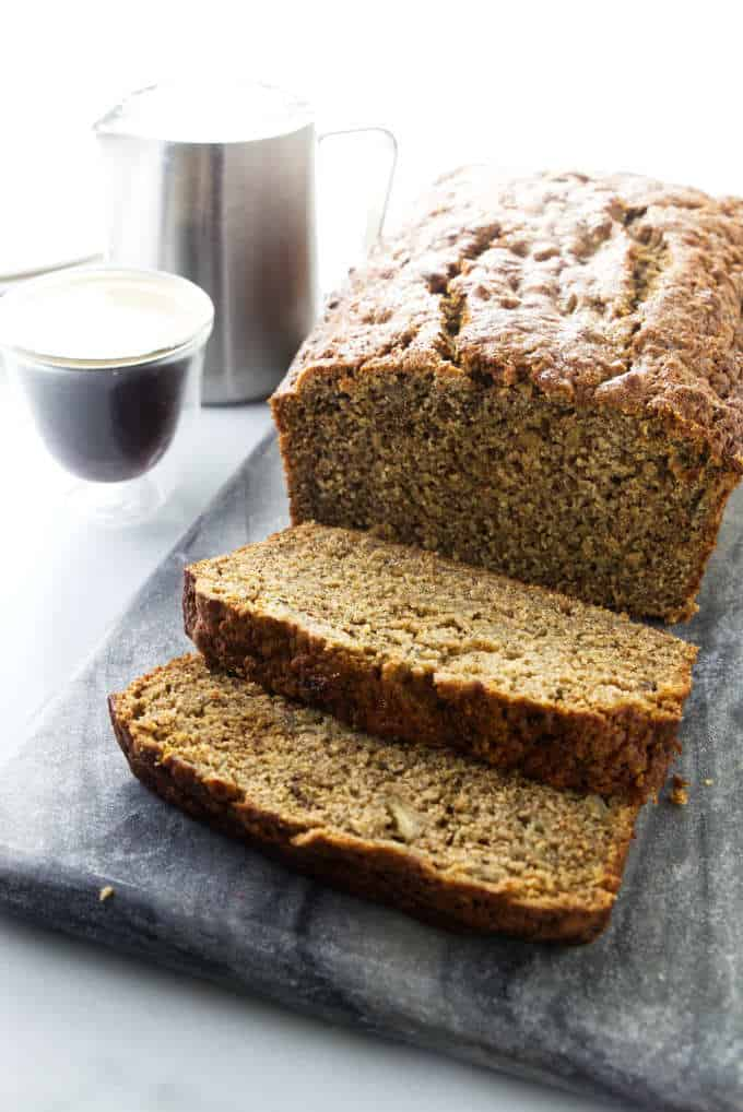 Spelt banana bread with a cup of espresso in the background