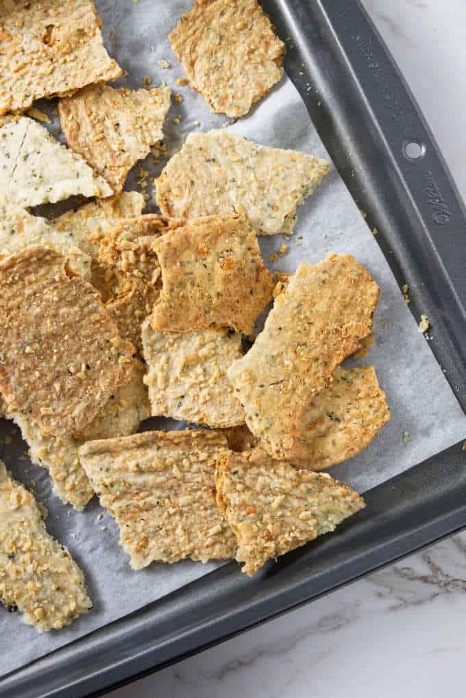 Sourdough discard crackers on a sheet pan.