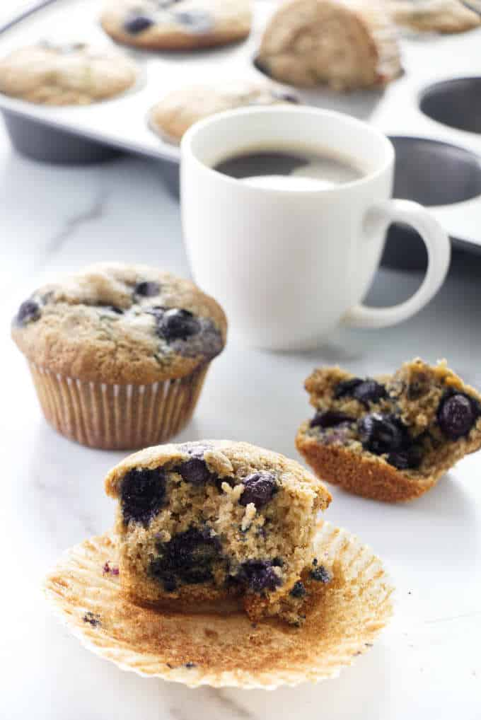 Blueberry muffins with a cup of coffee.