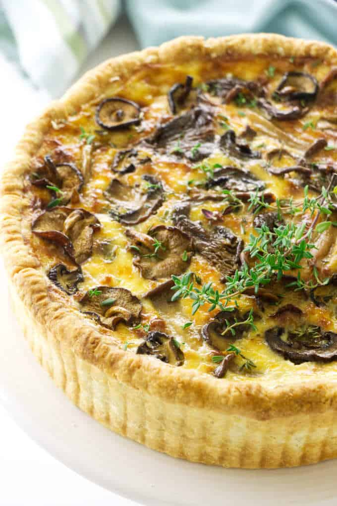 Overhead view of Mushroom quiche, towel in background