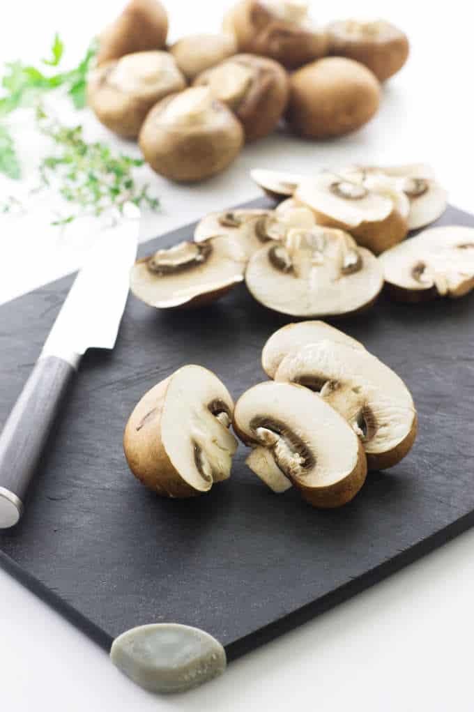 Mushrooms, cutting board, knife