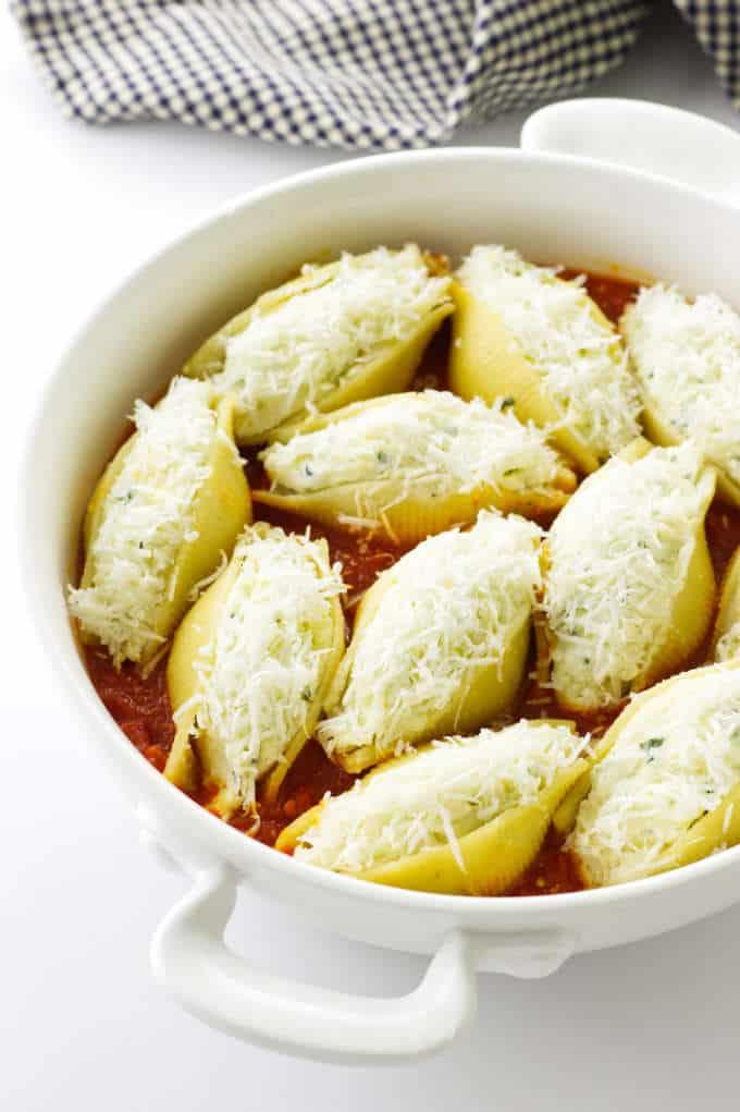 Casserole dish of stuffed pasta shells ready to bake