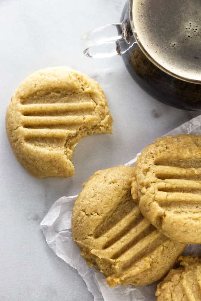 Three honey tahini cookies and a cup of coffee.