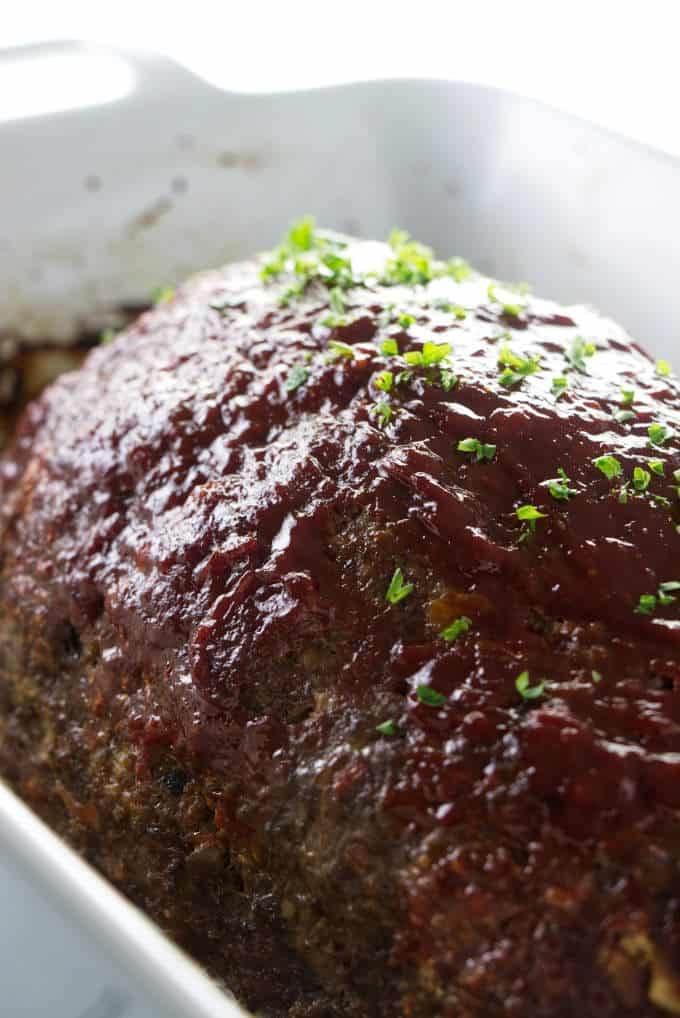A loaf of meatloaf with a sweet glaze on top.
