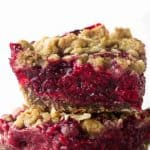 Two fresh raspberry bars stacked on each other.