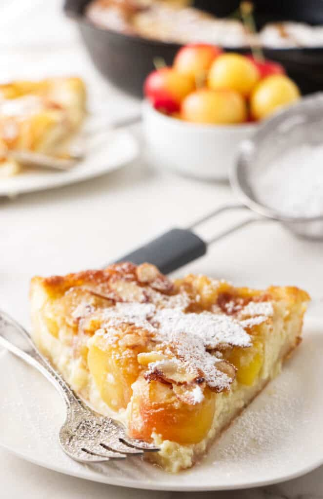A slice of cherry clafoutis on a plate.