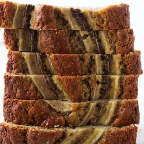 Slices of sourdough banana bread stacked on top of each other.