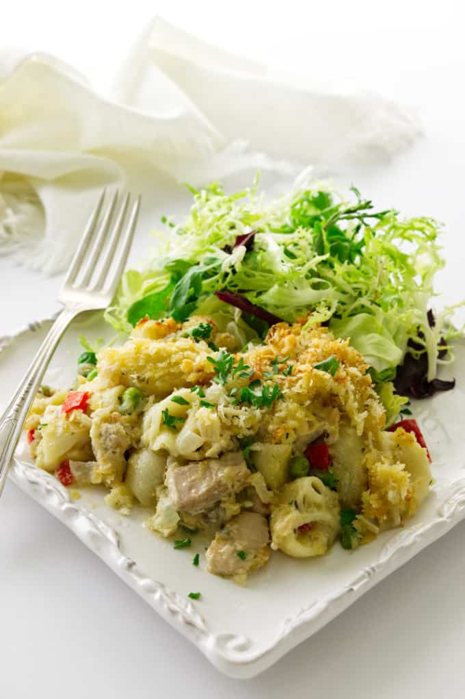 Overhead view of tuna pasta casserole with a side of salad