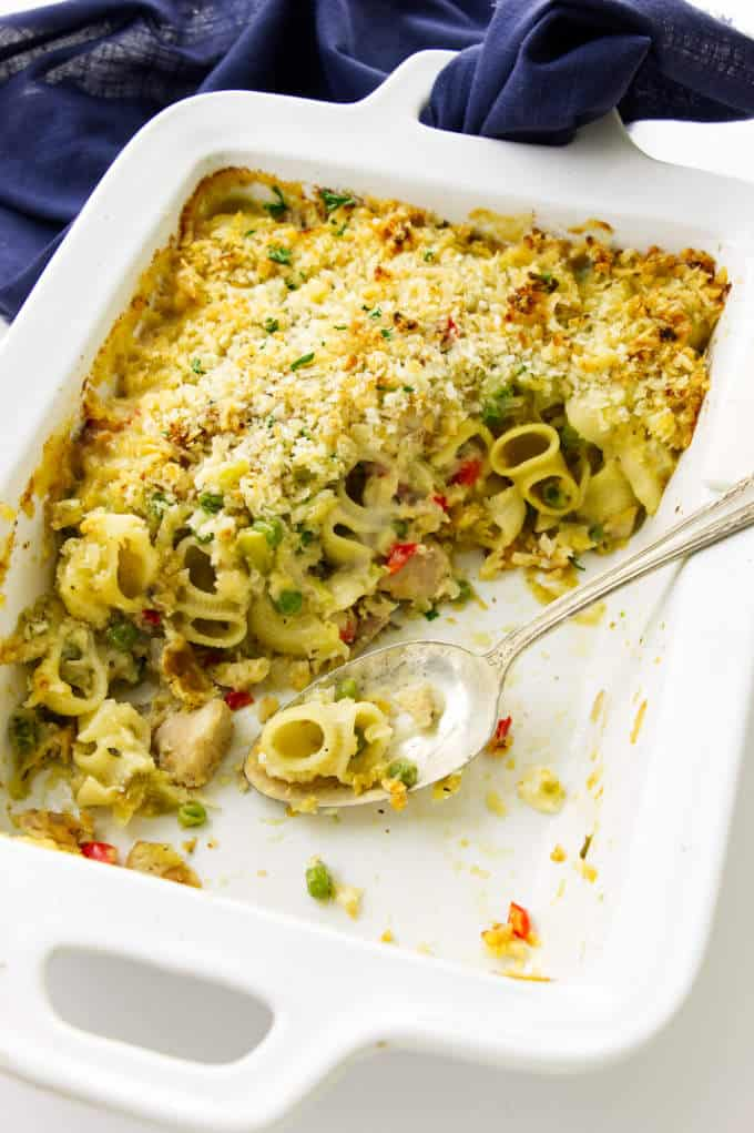 Overhead view of a dis of tuna pasta casserole with a spoon