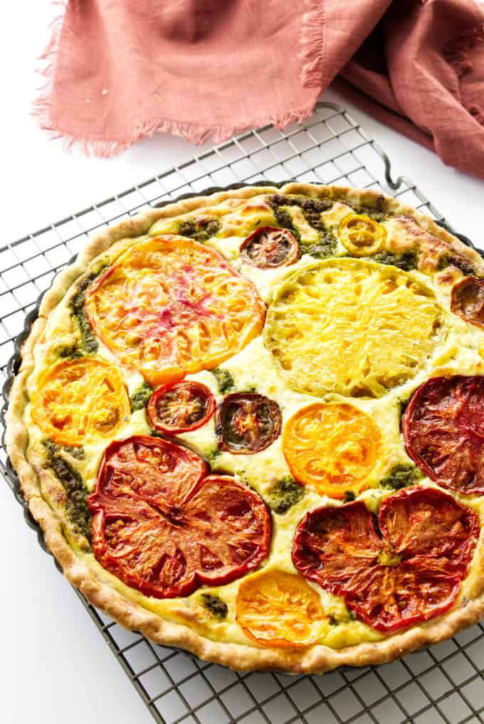 Overhead view of a tomato tart on a cooling rack