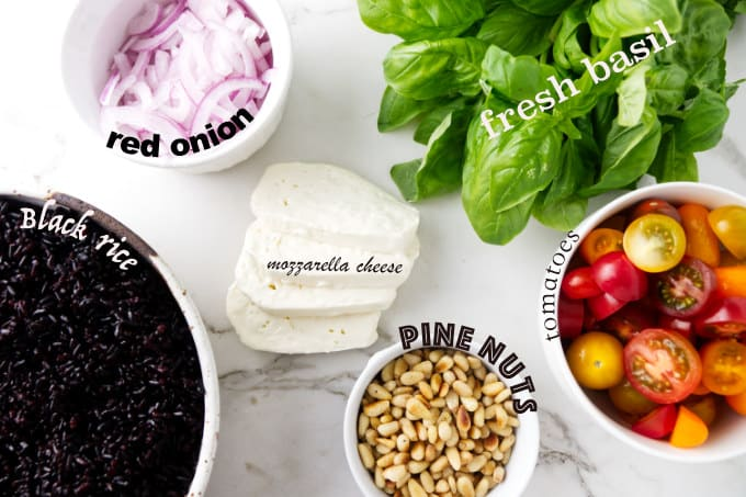 Ingredients needed for black rice salad with tomatoes and basil