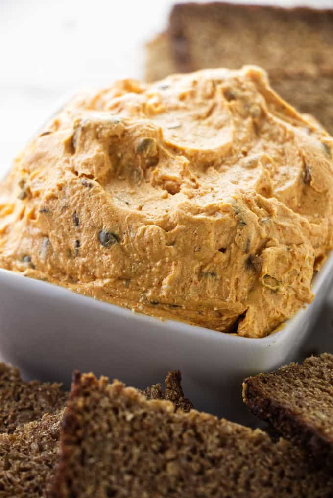 A close up photo of creamy Liptauer cheese spread and some rye bread.