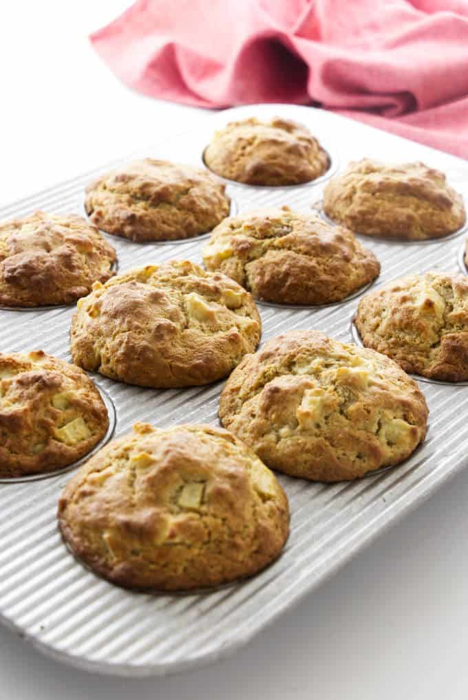 Apple ginger muffins in muffin tin.