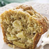 An apple ginger muffin cut in half.