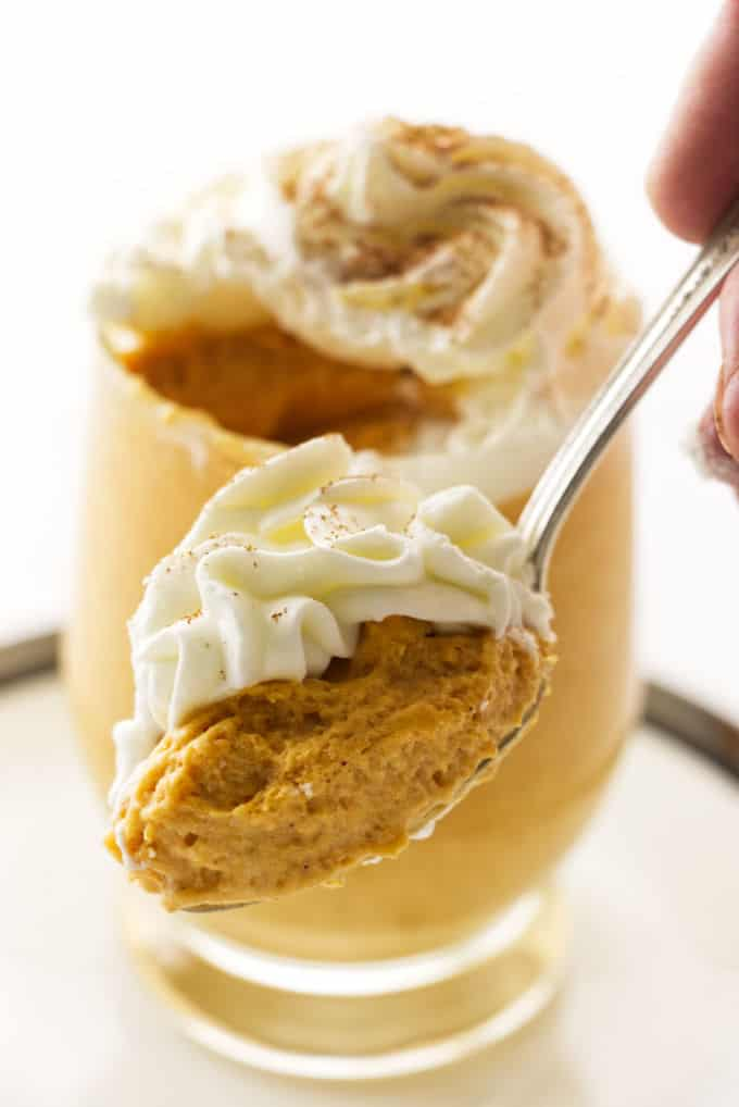 A spoon with a scoop of pumpkin mousse.