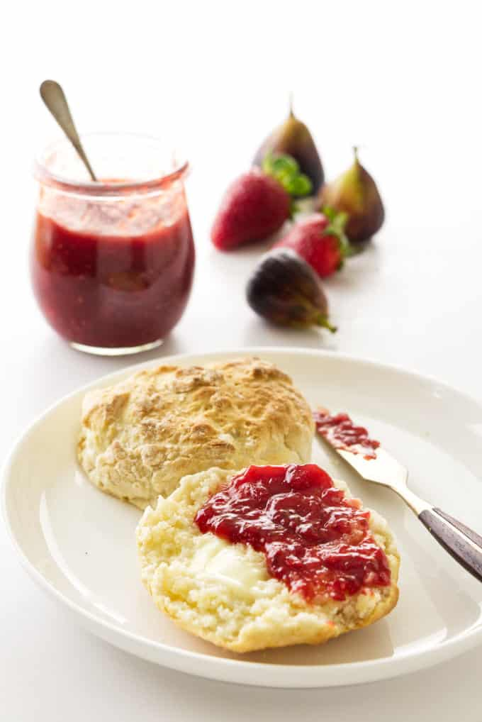Strawberry fig jam spread on a biscuit.