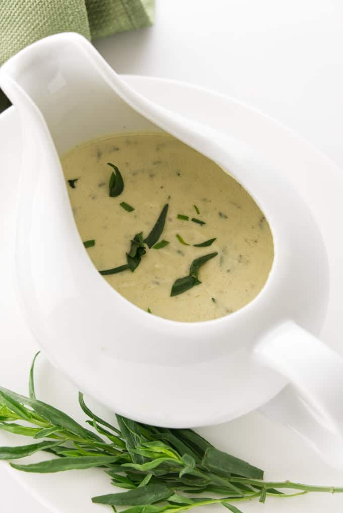 Creamy tarragon sauce in a dish with a spout.