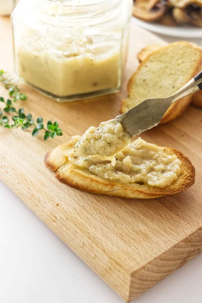 Roasted garlic spread on a piece of toast.