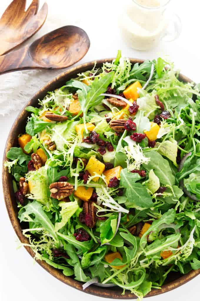 Overhead photo of butternut squash salad with mixed greens.