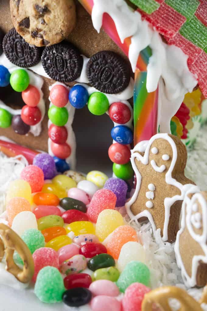 A jellybean path lined with gumdrops going to the door of a gingerbread house.
