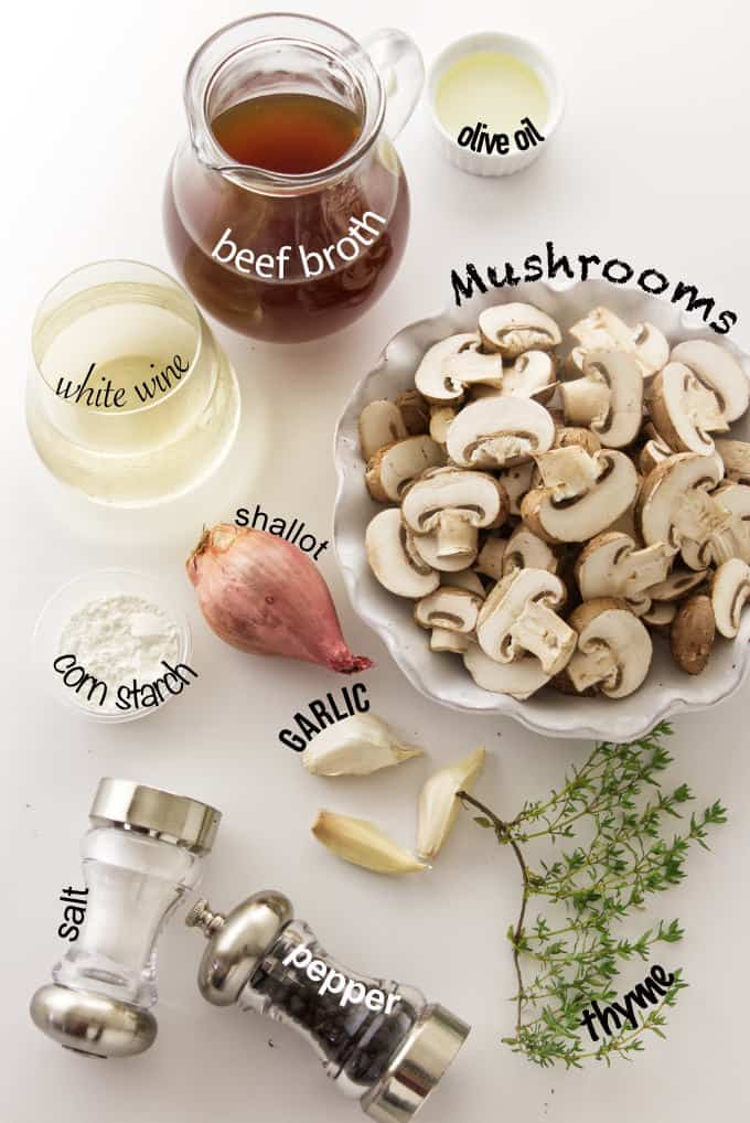 Ingredients needed for white wine mushroom sauce.